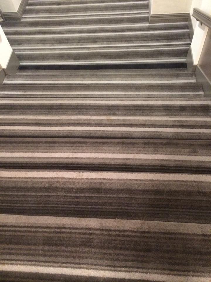 poorly carpeted stairs