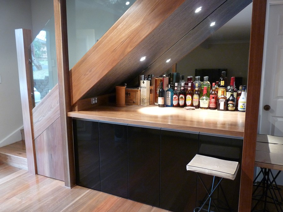 21 genius design ideas for the space under your stairs