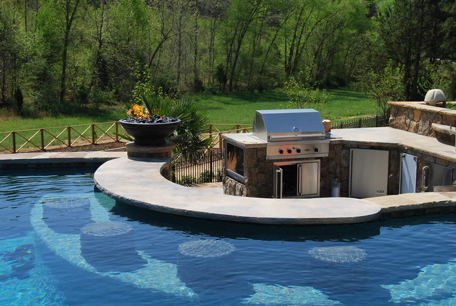 outdoor kitchen with swim-up bar