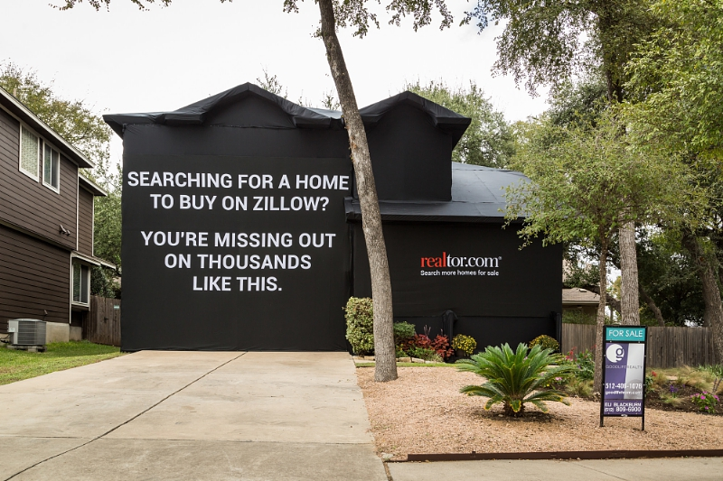 targets zillow with antagonistic house wrapping ad campaign
