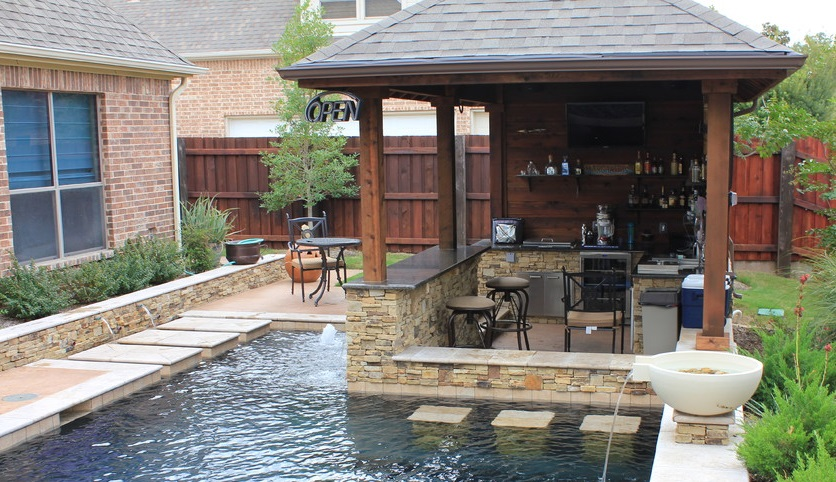 21 insanely clever design ideas for your outdoor kitchen for Pool house designs with outdoor kitchen