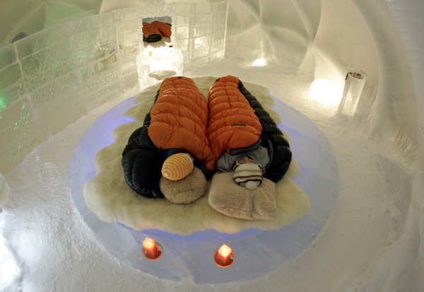 A couple relax on mouton spread atop an ice bed at ice hotel in Shimukappu town, Japan's northern island of Hokkaido