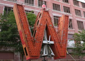 "Woodward's original ""W"" now sits in front of the redeveloped Vancouver building as a public art piece."