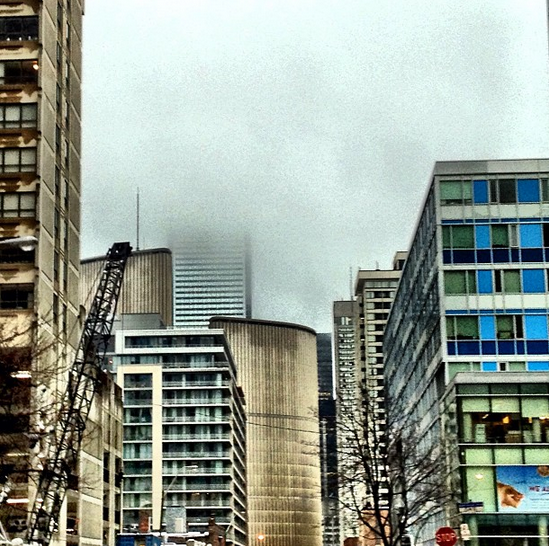 Backside of Toronto's city hall and disappearing towers.