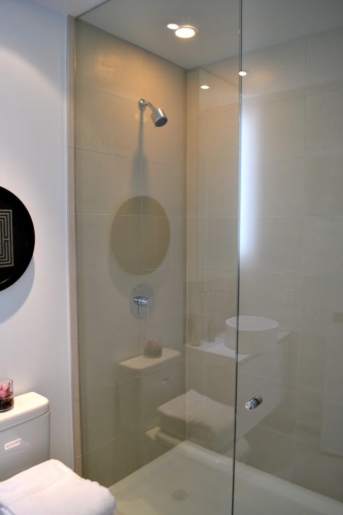 Ensuite shower with frameless glass door and pressure balanced shower controls.