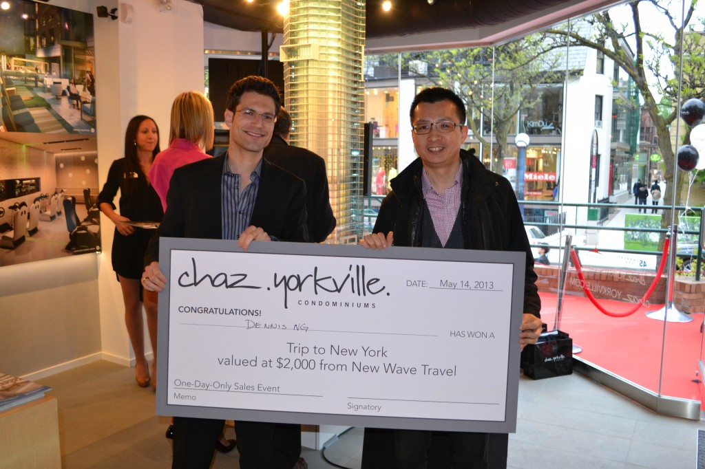 Harley Nakelsky, VP at Baker Real Estate Incorporated, and Dennis Ng, the winner of a raffle prize trip to NYC!