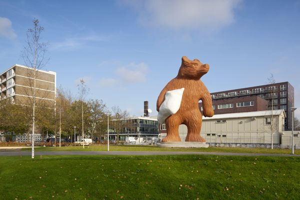 Amsterdam is home to The Steelman, a 37 foot concrete structure in the shape of a bear holding a pillow. Hoffman created the piece in 2011.