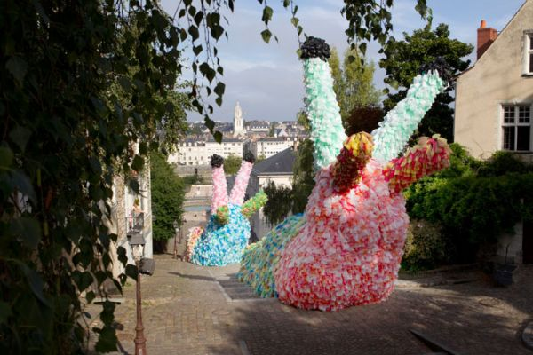 The Slow Slugs were made out of 40,000 plastic bags and were placed ascending a staircase in Angers, France, towards a city church, meant to symbolize a slow crawl to death.