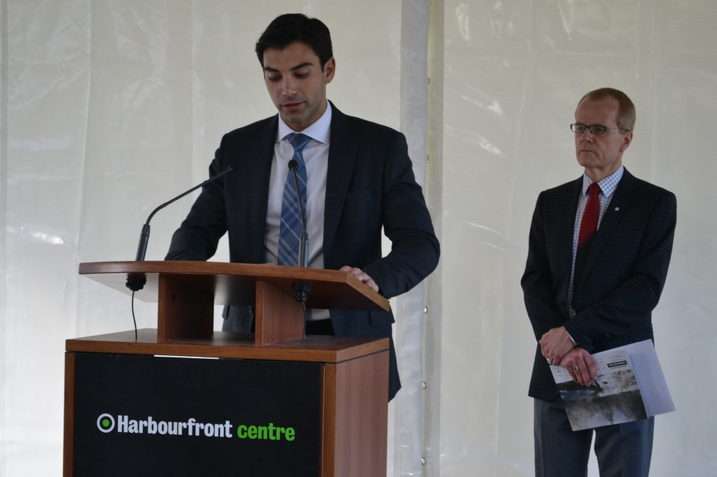Harbourfront Centre CEO, William Boyle looks on as Adam Menkes, of Menkes Developments spoke about the exhibit.