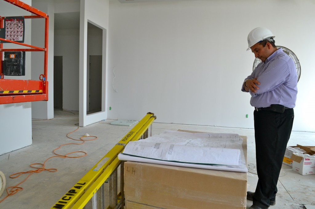 Serge looks over the floor plans while he explains what's in store for the main room of the centre.