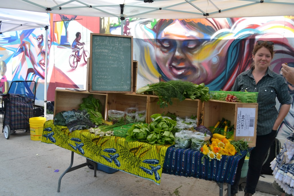 The market was filled with the aroma of fresh veggies and fruit.