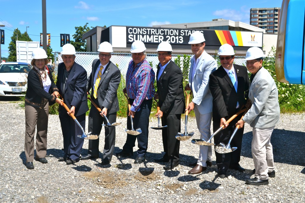 Councillor Lynn Foster, Councillor Nick Papa, Councillor Greg Baros, Zancor Homes' Nick Cortellucci, Councillor Carmine Perelli, Zancor Homes President Fabrizio Cortellucci, Deputy Mayor Vito Spatafora, and Councillor Goodwin Chan take part in the official groundbreaking.