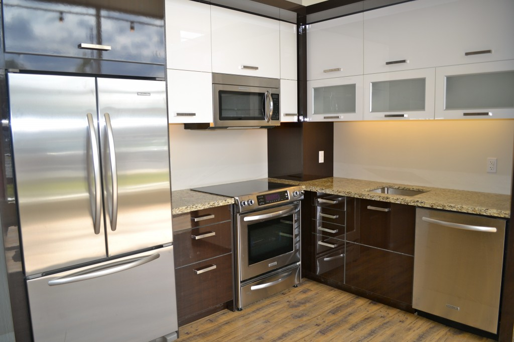 The kitchen in the upgraded model suite is complete and looking sleek.