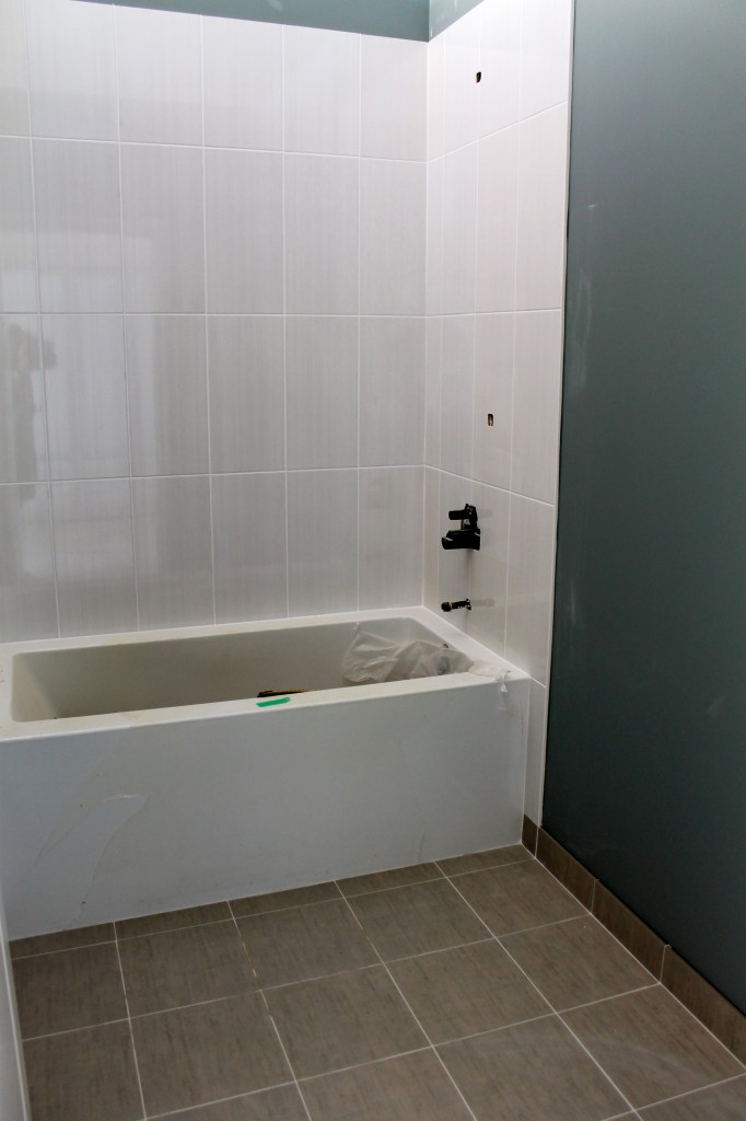 The bathroom in one of the model suites is almost complete with a soaker tub and beautiful tiles.