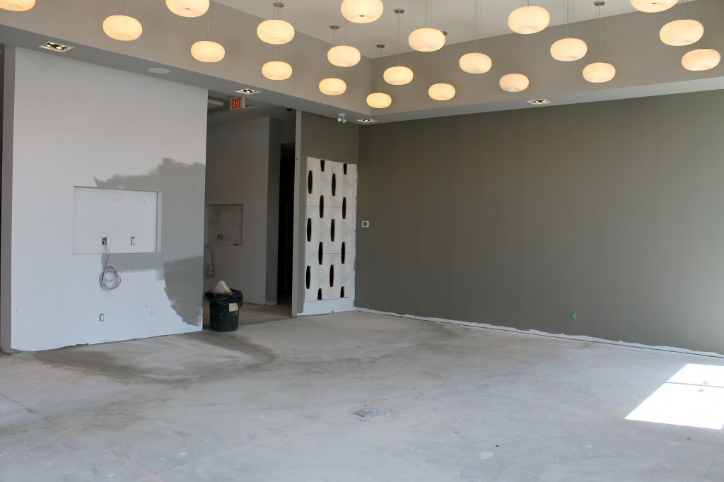 We love the light fixtures and colour chosen for the main presentation area.