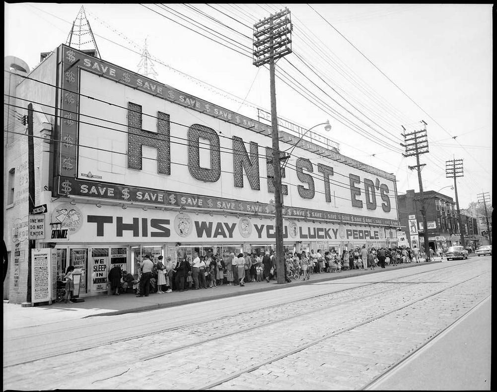 One of the many massive lineups of people looking for a bargain at Honest Ed's, this photos is from sometime during the 60s. Photo: Toronto Archives
