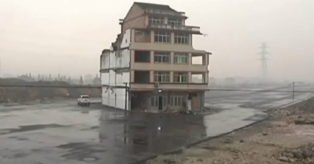 house in the middle of highway