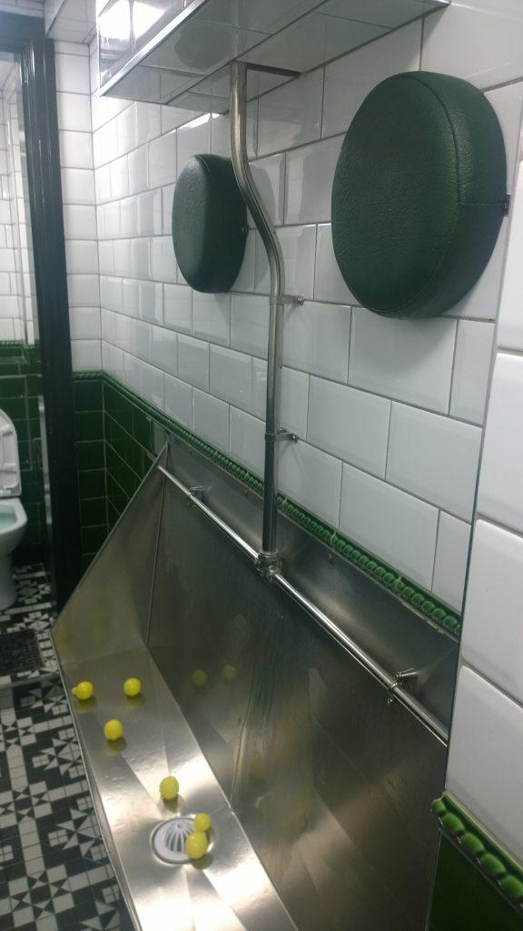 urinal with headrest