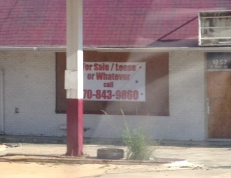 desperate real estate sign