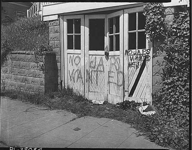 Graffiti on Japanese American home