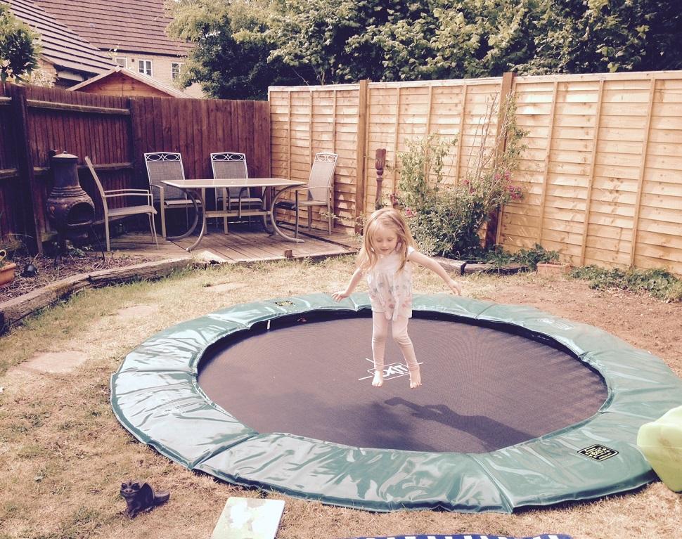 sunken trampoline backyard