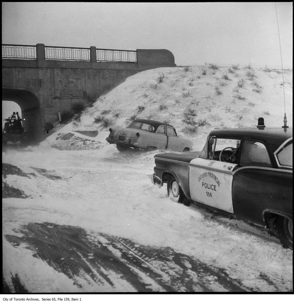 File consists of photographs of OPP (Ontario Provincial Police) cars in the snow.