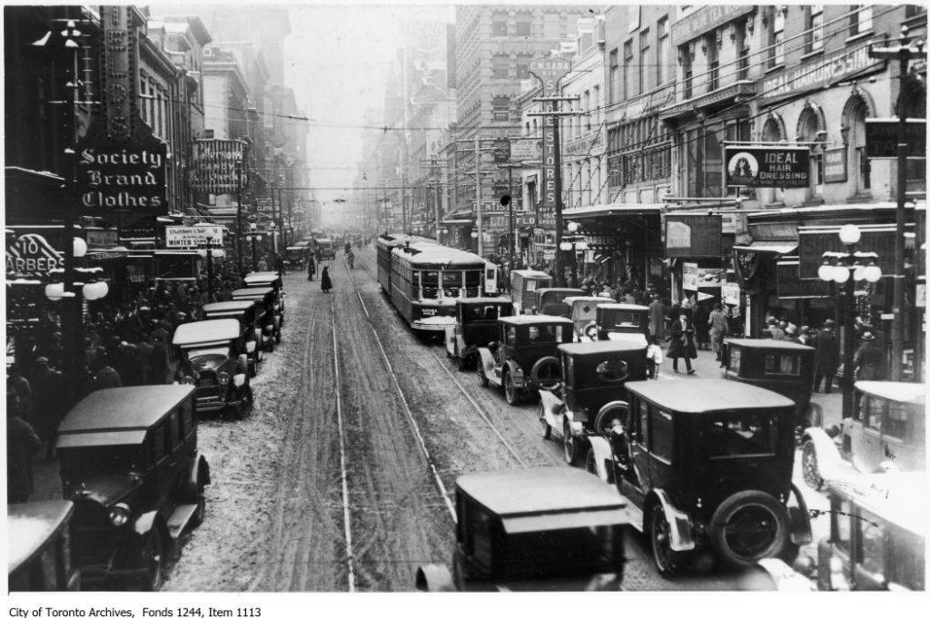 Noon hour traffic, Yonge Street looking north from King Street. - December 24, 1924